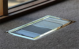 heating duct, metal frame on brown carpet